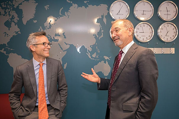 """Stephen Greenblatt and Dean Robin Kelsey chat about Greenblatt's new book """"The Rise and Fall of Adam and Eve"""" in the lobby of Harvard Global Support Services."""