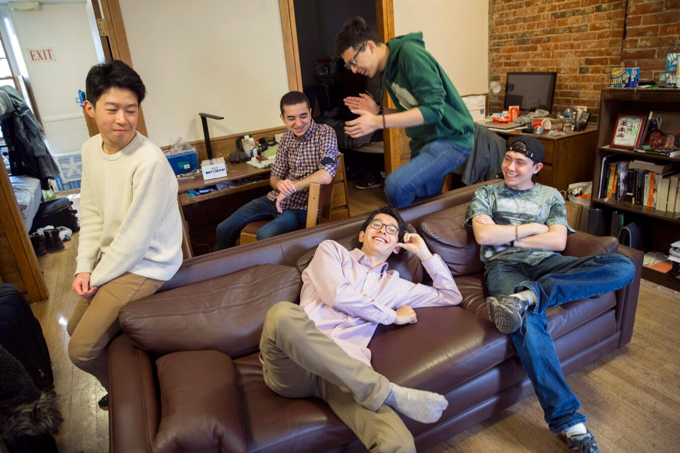 "Roommates, Luke Xu, (from left to right) Abdelrhman ""Abdul"" Saleh (plaid shirt), Sung Ahn (green sweatshirt), Kenneth Shinozuka (wearing socks), and Clifford ""Scotty"" Courvoisier, All class of '20 live in Holworthy Hall together."