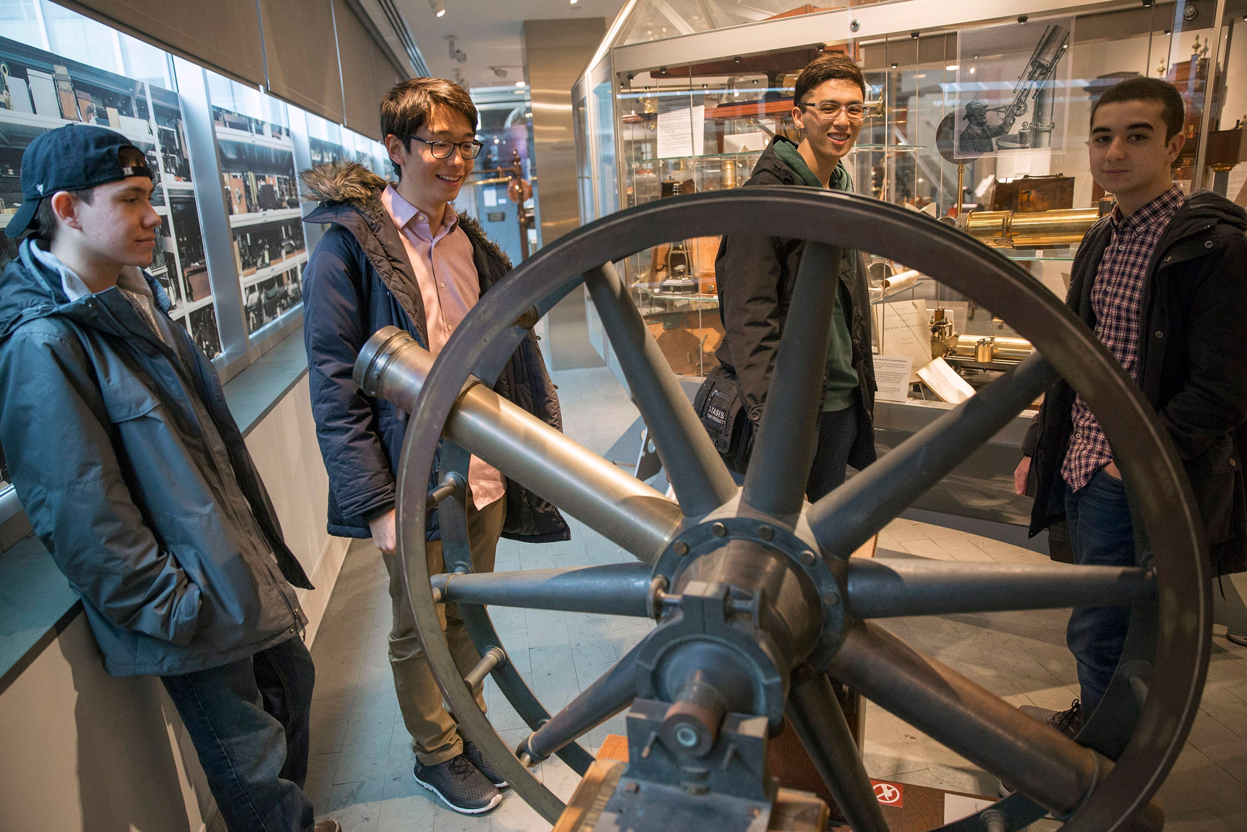 "Roommates, Clifford ""Scotty"" Courvoisier, Kenneth Shinozuka, Sung Ahn, and Abdelrhman ""Abdul"" Saleh, (from far rear left to right), All class of '20 who live in Holworthy Hall, view a ""Transit Circle"" inside The Collection of Historical Scientific Instruments in the Science Center."