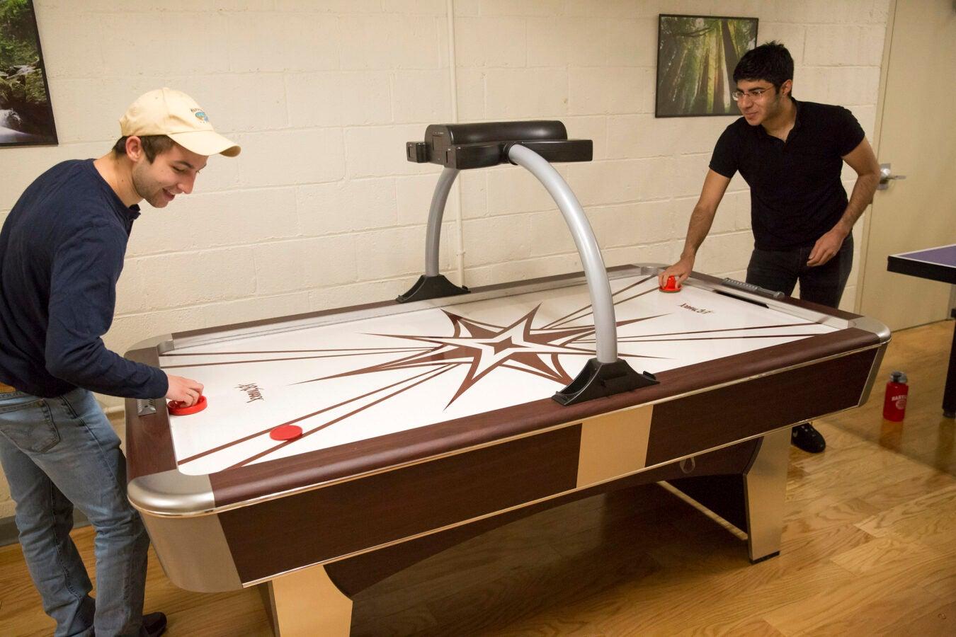 Roommates in Wigglesworth: Scott Kall '20 (MA), left, plays air hockey with Soheil Sadabadi '20 (Iran).