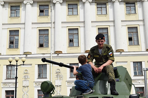 "Reyes explored streets, cities and tourist spots. ""By the end of the summer I felt as though I were a regular Muscovite, or something close,"" he said. Here a young boy talks to a Russian naval officer in Palace Square in St. Petersburg."