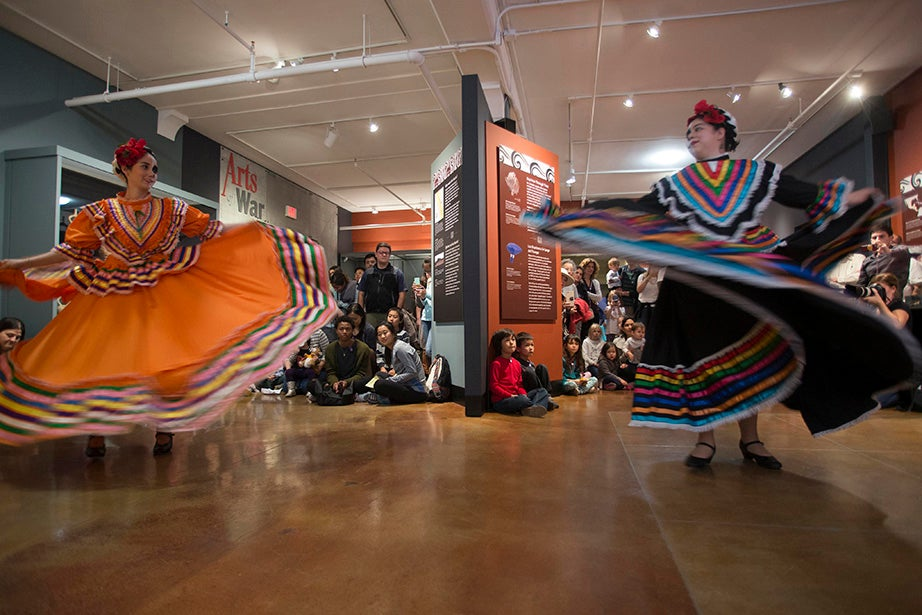 Dancers move at the Peabody Museum's Day of the Dead Family Celebration. Photo by Tony Rinaldo