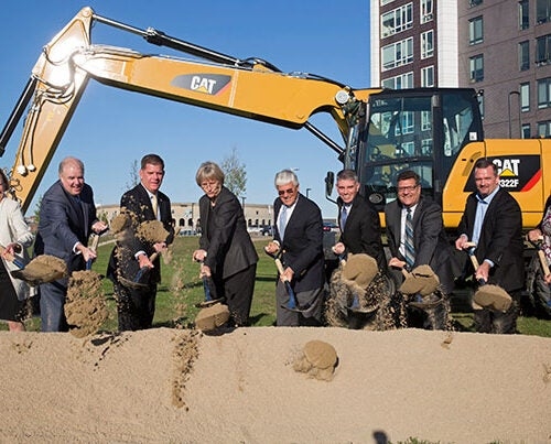 The groundbreaking ceremony at Smith Field included Executive Vice President Katie Lapp (from left), Rep. Brian Honan, Boston Mayor Martin J. Walsh, President Drew Faust, Gen. George Casey Jr., Brian Golden, City Councilor Mark Ciommo, Rep. Michael Moran, and City Councilor Annissa Essaibi George.