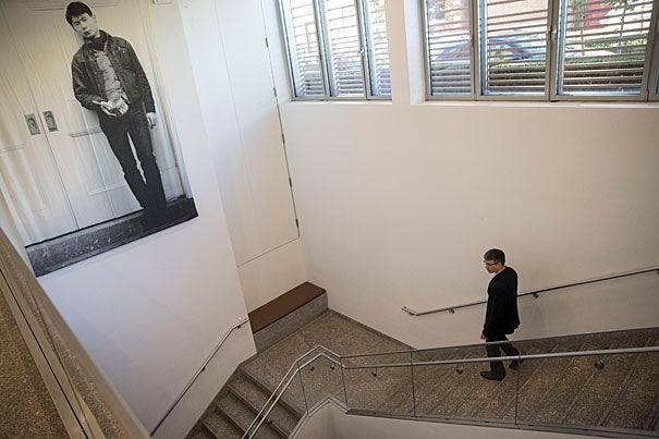 """""""Irresolution: The Paintings of Yoshiaki Shimizu,"""" an intimate exhibit at the CGIS is marked by a large banner showing the artist at 24 years old."""