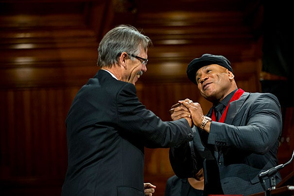 """Glenn Hutchins congratulates honoree LL Cool J at the fifth annual Hutchins Center Honors. """"Stay strong,"""" said LL Cool J. """"Fear not. Stay faith-filled. Better days are coming."""""""