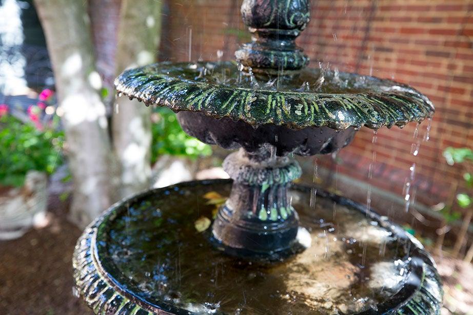 A fountain drips in a corner near the Plimpton Street entrance.