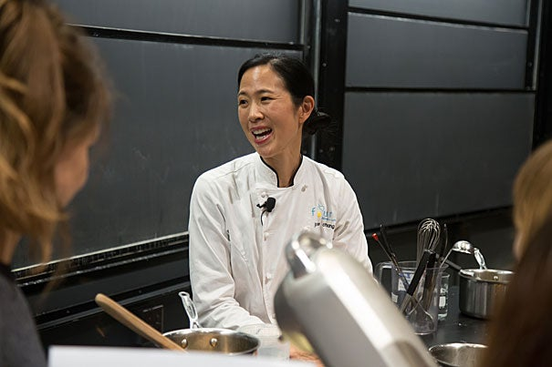 """Joanne Chang '91, founder of Flour Bakery, demonstrated the science and culinary versatility of sugar for 500 listeners as part of Harvard's """"Science and Cooking"""" public lecture series."""