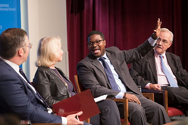"At ""The Lure of the Prosperity Gospel in the Age of Trump,"" panelist Jonathan Walton (center)  and E.J. Dionne (right) discussed the paradoxes of the evangelical tradition and how Trump has capitalized on its appeal to both rich and poor."