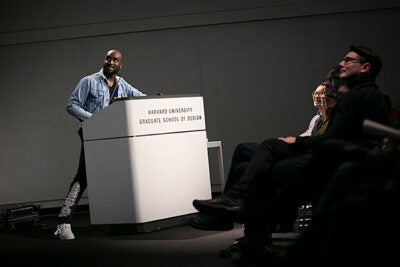 "American creative designer, DJ, and founder of Off-White Virgil Abloh (left) delivers his lecture ""Insert Complex Title Here,"" encouraging the audience to find their own creative voices."
