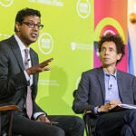 At a HUBweek event in Faneuil Hall, Atul Gawande (left) and Malcolm Gladwell discuss the use of checklists and other systems interventions to reduce lethal mistakes in the medical practice.