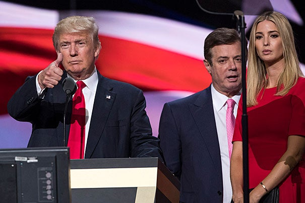 Federal charges have been brought against two former Trump advisers, including Paul Manafort (center). If evidence links Trump to criminal activity, Congress may have to consider impeachment. But as Harvard Professor Cass Sunstein points out, the Constitution sharply limits the category of impeachable offenses.