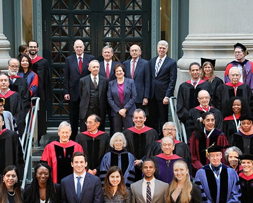 On the steps of Langdell Library, Harvard Law School faculty surround six Supreme Court justices. Back row, from left: Associate Justice Anthony M. Kennedy '61; Chief Justice John G. Roberts Jr. '79; Associate Justice Stephen G. Breyer '64; and Associate Justice Neil Gorsuch '91. Front row: Associate Justice (retired) David H. Souter '66 and Associate Justice Elena Kagan '86, the former dean of HLS.