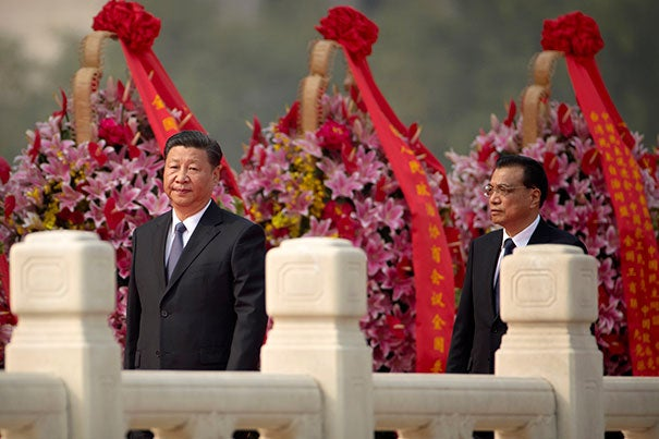 Chinese President Xi Jinping (left) is likely to begin his second term as general secretary of the Communist Party as the nation prepares to solidify its status as a global leader.