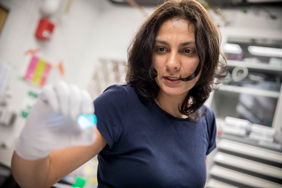 Shima Parsa works with a UV-visible spectrometer. The Weitz Lab is active in the Office for Sustainability's Shut the Sash Competition, which aims to reduce the energy consumption of fume hoods.