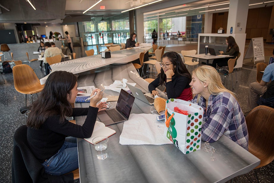 Natalie Kim '18, (from left) Amanda Fang '18, and Hannah Keating '20 set up camp at one of the space's many long tables. Kris Snibbe/Harvard Staff Photographer