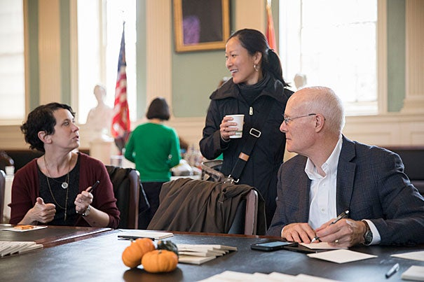 Cristy McGoff (from left), Denise Moody, and Steven Niemi pen letters of thanks before taking donations to the Harvard Square Homeless Shelter at the Giving Thanks Open House.