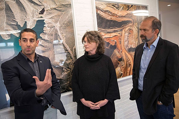 Nikhil Advani, (from left) University of Alaska, Nancy Knowlton, World Wildlife Fund, and Cam Webb talk about the best ways to understand and communicate about the environment's future inside the Harvard University Center for the Environment before the evening event at the Geo Lecture Hall.