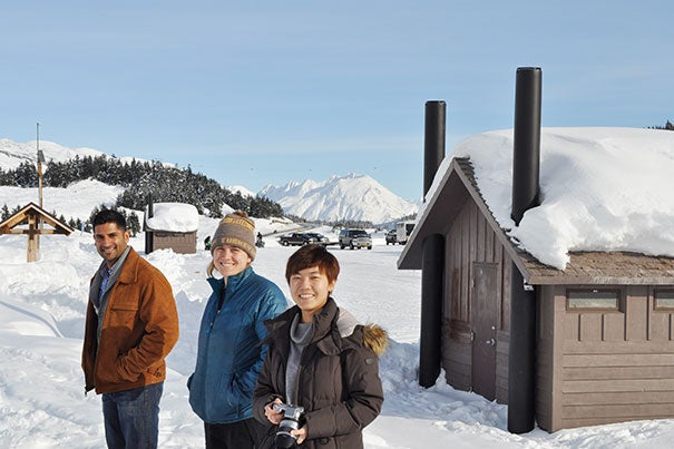 Vik Bakshi (left), Caroline Lauer, and Yuan Zhang were part of a team of graduate students that traveled to Alaska to develop an innovative plan for reducing carbon emissions by preserving existing forest land.