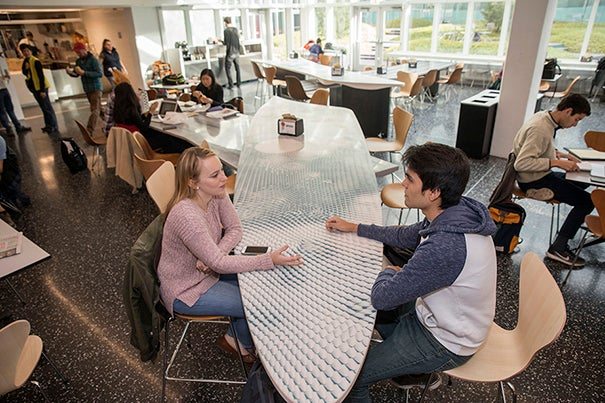 Maria McLaughlin '18 and Mauricio Ruiz '19 engage in conversation in the new Pritzker Commons. Kris Snibbe/Harvard Staff Photographer