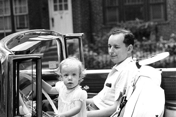 "Susan Faludi in her father's car in New York City, early 1960s. Faludi, who wrote about her gender-transitioned father, is among the panelists at the Schlesinger Library's ""Hidden in Plain Sight: Family Secrets and American History."""