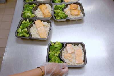 Each meal includes a protein, grain or starch, and a vegetable. Video still by Joe Sherman/Harvard Staff