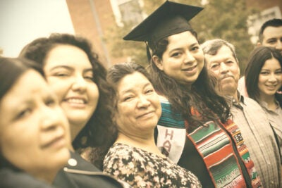 Yesenia Ortiz at graduation surrounded by family.