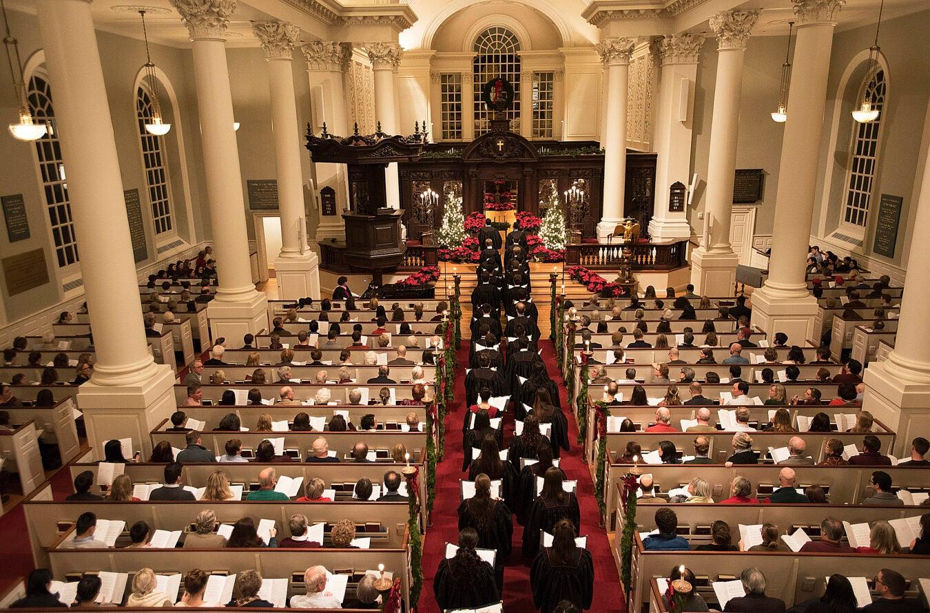 Harvard choir marches through sanctuary.