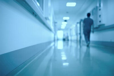 Image of doctor walking down corridor