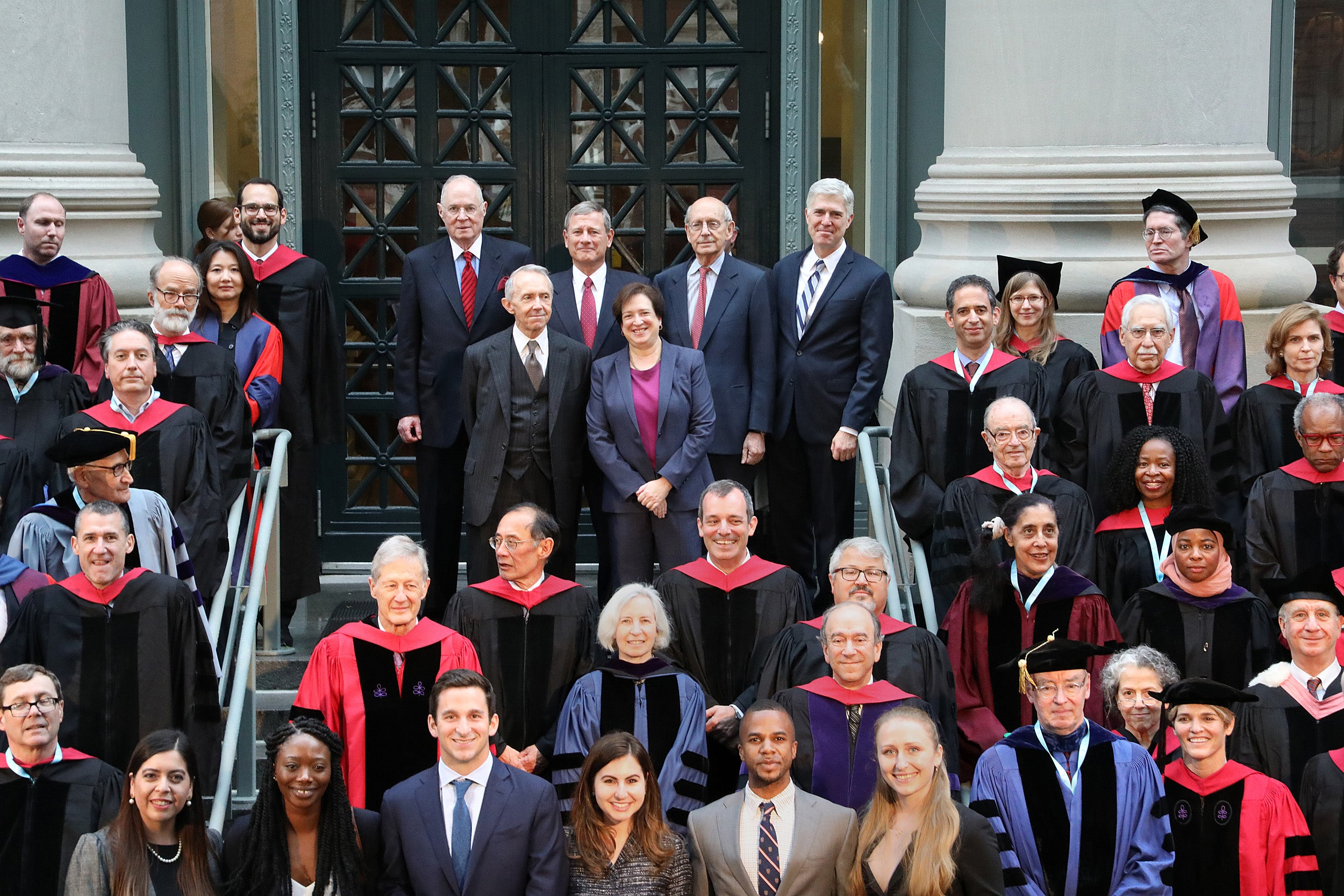 On the steps of Langdell Library, Harvard Law School faculty surround six Supreme Court justices.
