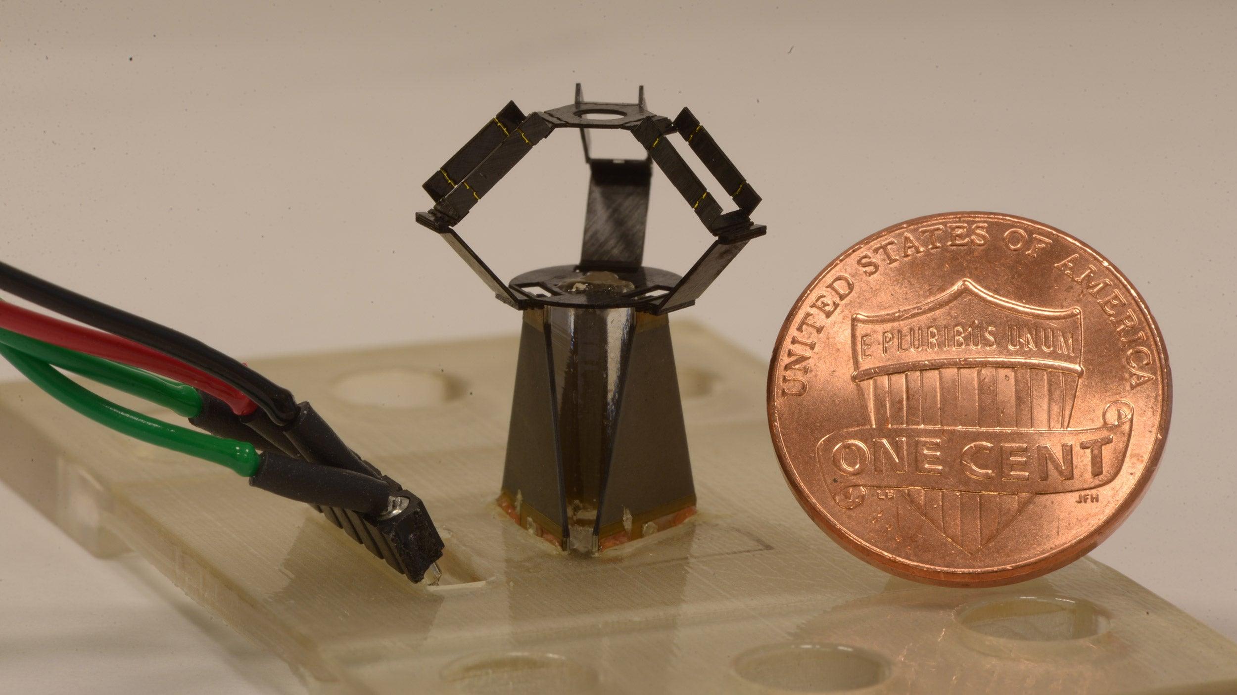 milliDelta robot next to penny