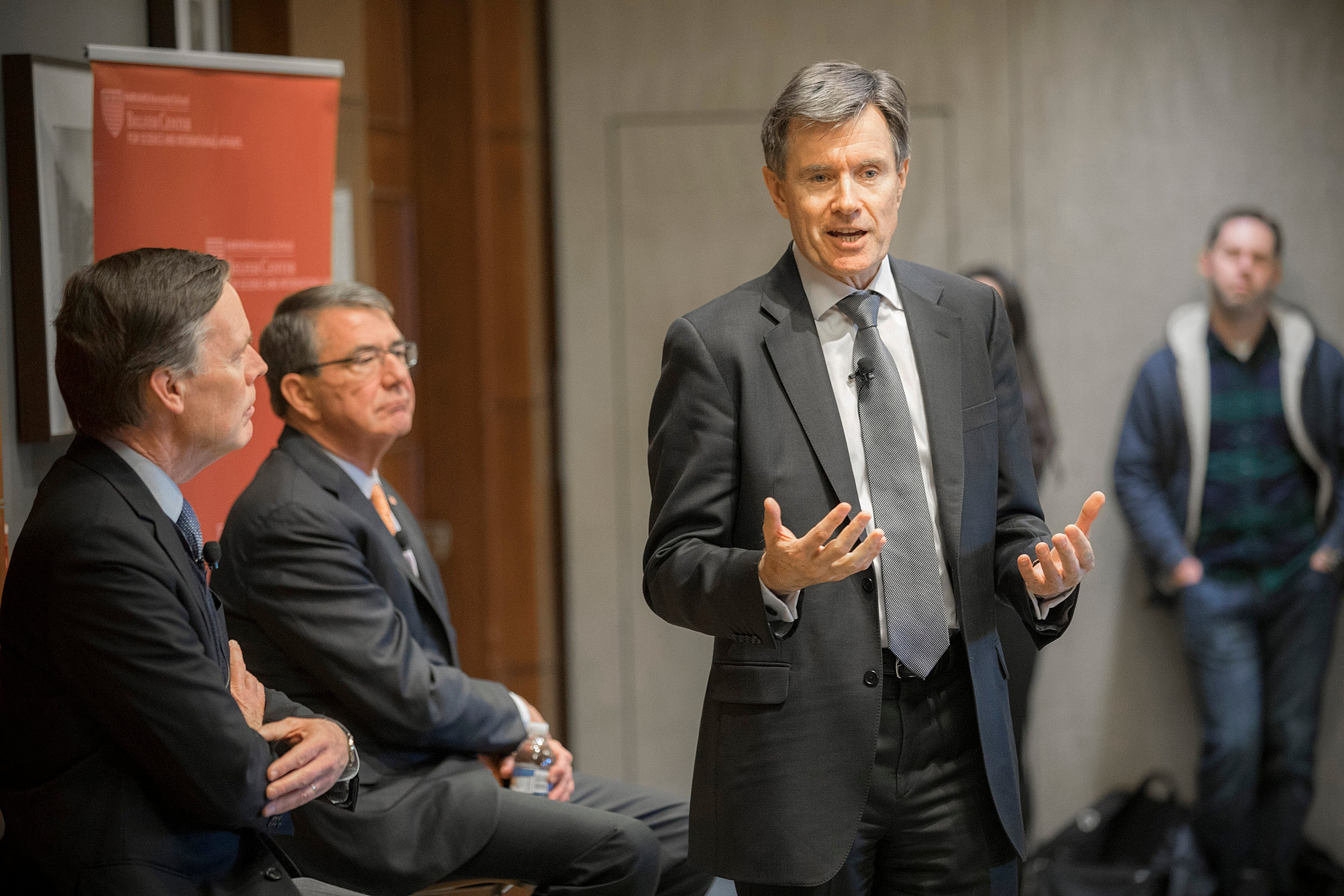 """During """"Intelligence gathering in the 21st century,"""" Nick Burns (from left) and Ash Carter listen as John Sawers, former head of MI6, discusses the challenges of the modern intelligence industry."""