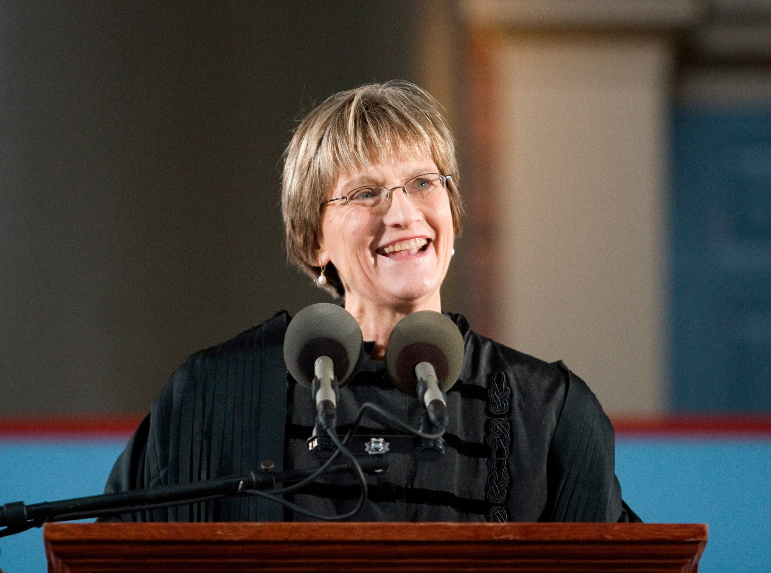 Drew Faust at podium during installation as Harvard president.
