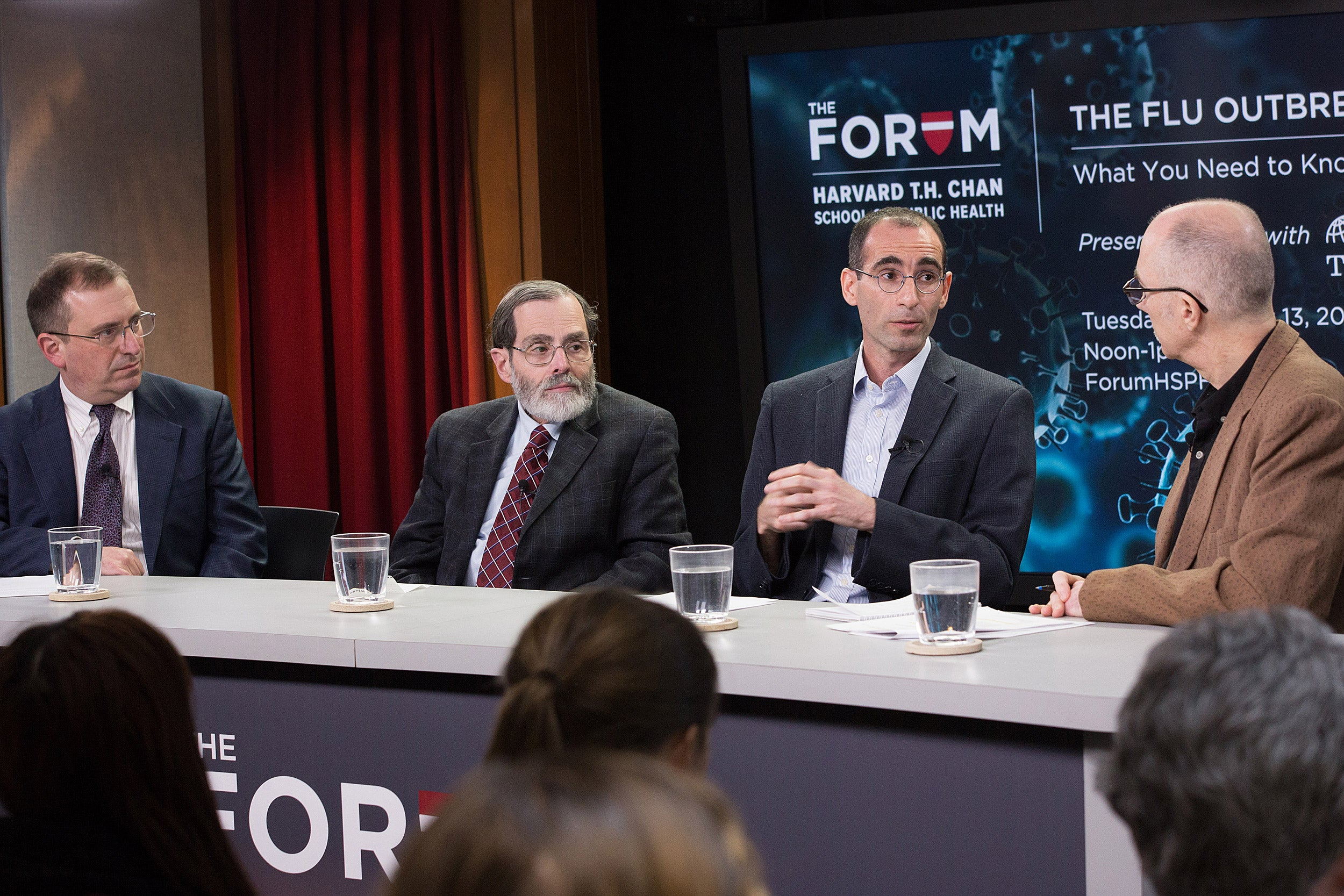 During a Chan School discussion on the flu, panelists Marc Lipsitch (from left), Alfred DeMaria, Yonatan Grad, and moderator Peter Thomson focused on the dangers of not getting vaccinated during a particularly virulent flu season.