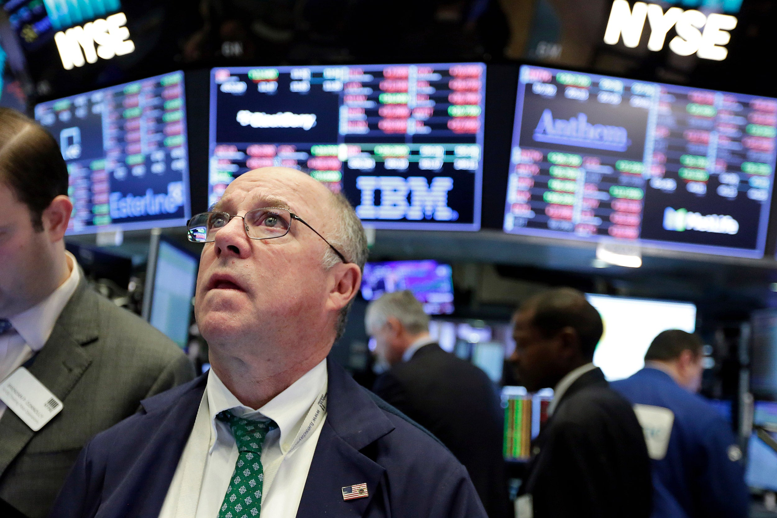 New York Stock Exchange Trader Frederick Reimer reacts as the Dow Jones industrial plunged on Monday.