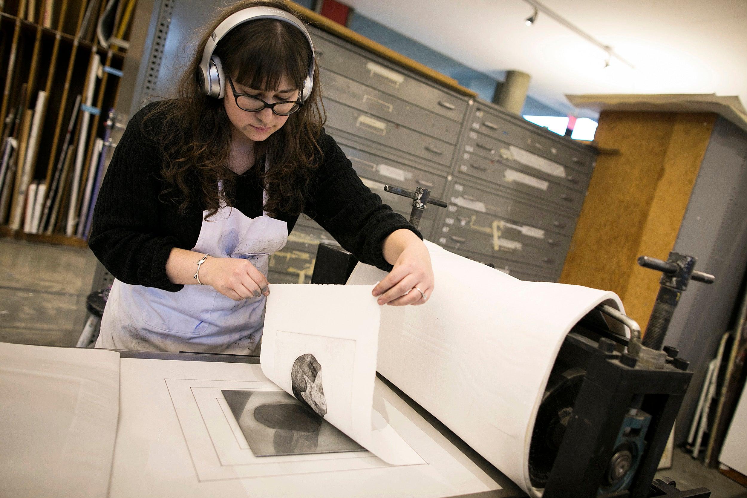 Graduate student Rachel Vogel tries her hand at printmaking.