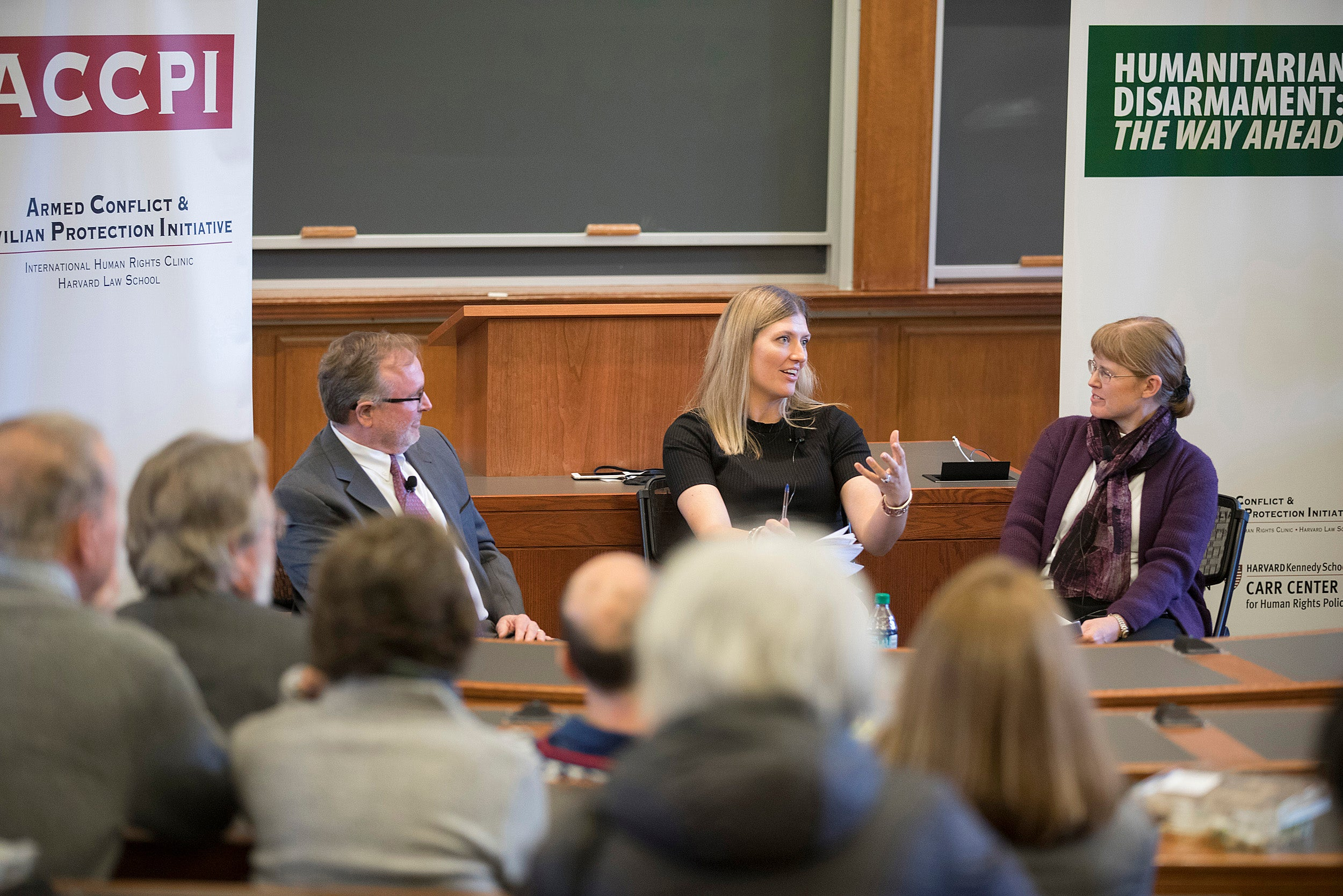 """During """"From Landmines to Nuclear Weapons,"""" a panel featuring Steve Goose (from left) and Beatrice Fihn and moderated by Bonnie Docherty of the Law School addressed the origins and evolution of humanitarian disarmament while reflecting on their roles negotiating treaties that ban landmines, cluster munitions, and nuclear weapons."""