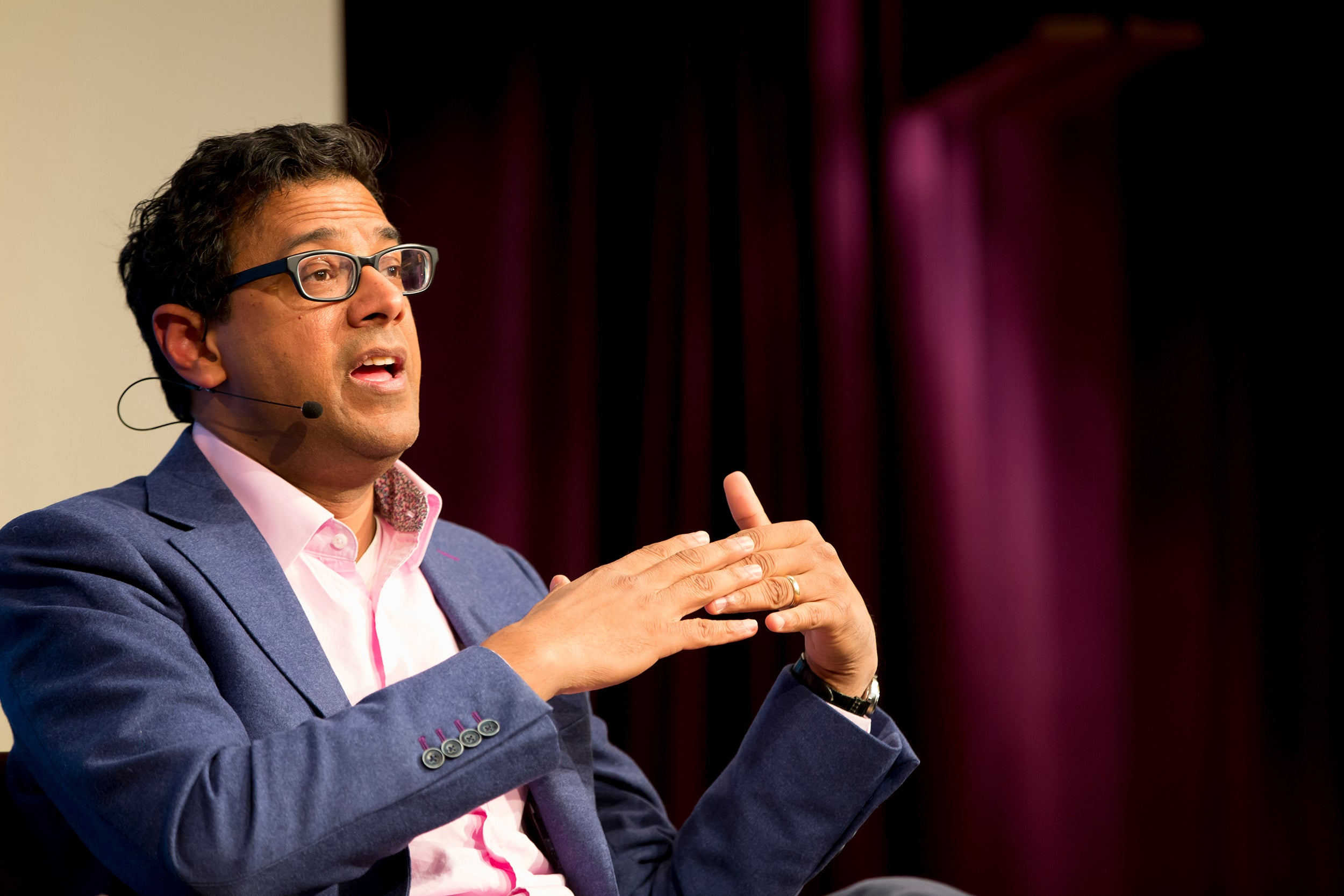At a JFK Jr. Forum talk with science journalist Cristine Russell (not pictured), doctor and author Atul Gawande discussed the state of public health and the effectiveness of public policies in combating health issues.