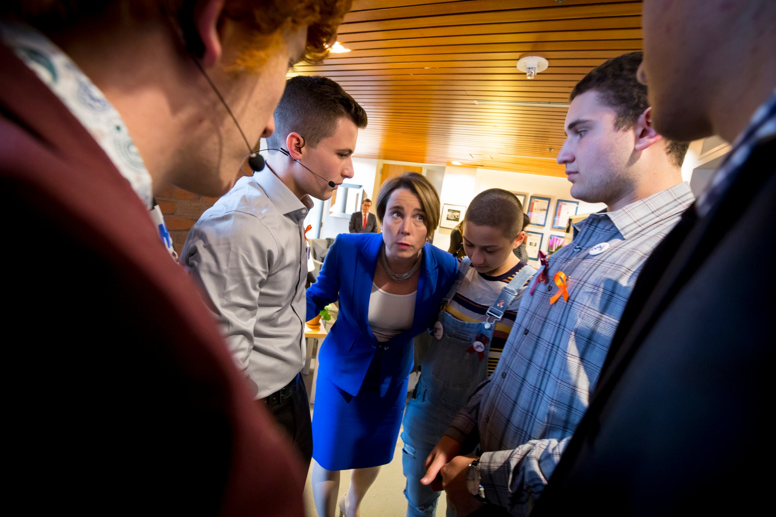 Attorney General Maura Healey huddles with Parkland students.