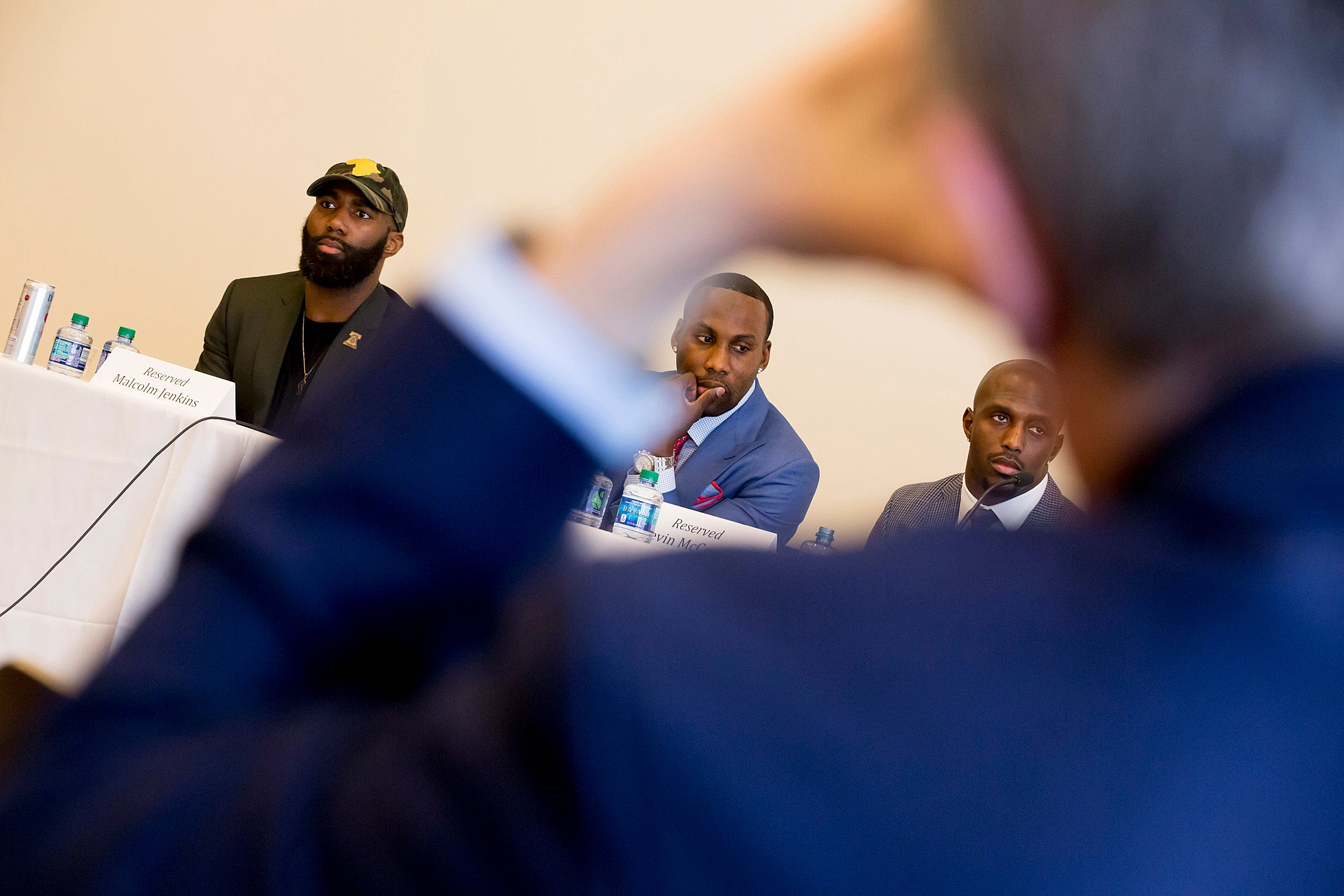 Current and former NFL players Malcolm Jenkins (from left), Anquan Boldin, and Devin McCourty came to Harvard Law School as part of the National Football League Player's Coalition project to promote social justice.