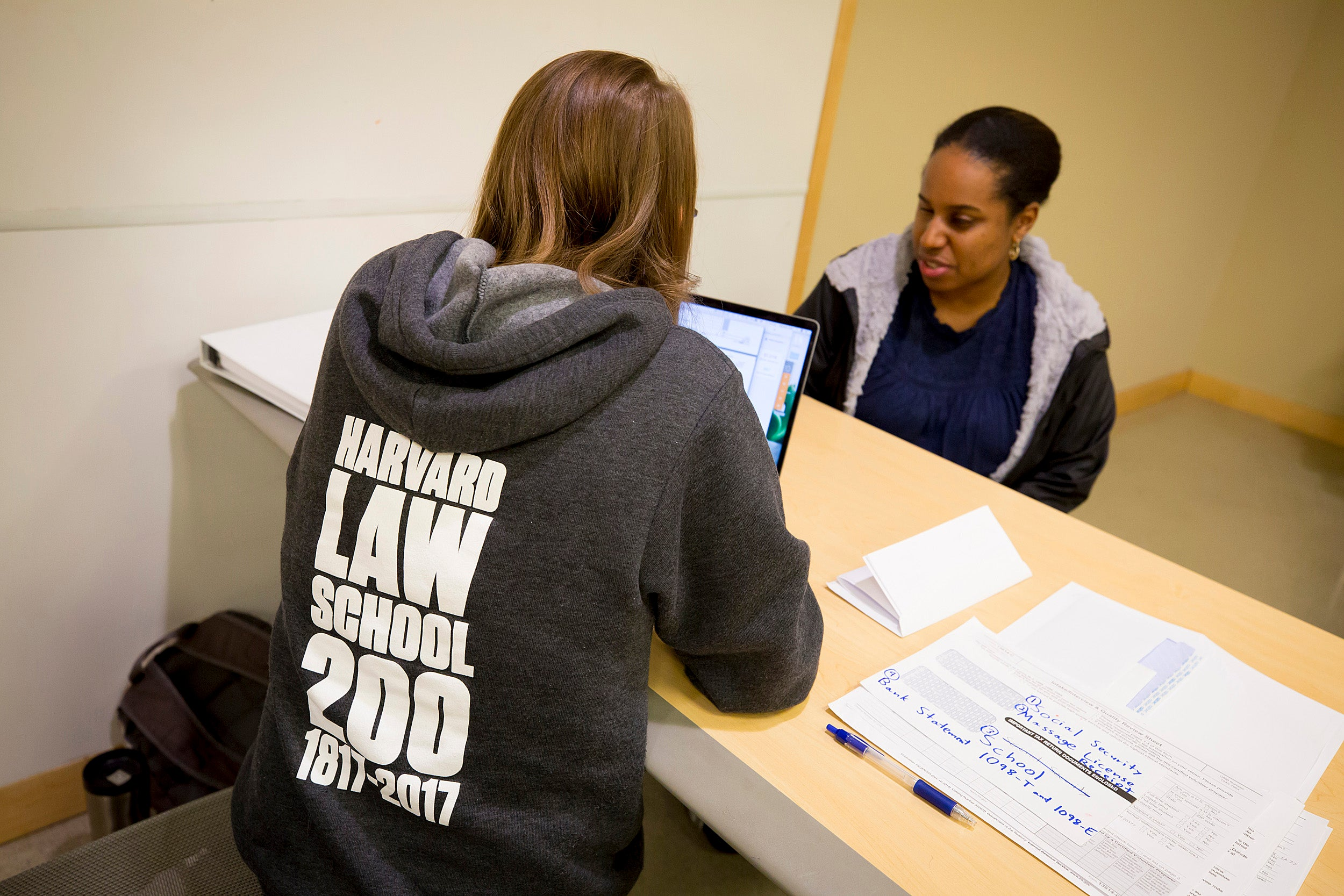 Rebekah Holtz, J.D. '19 (left), assists Claire Gauthier of Newton with her taxes as part of Harvard TaxHelp, a student-run organization that offers free assistance to low-income clients.