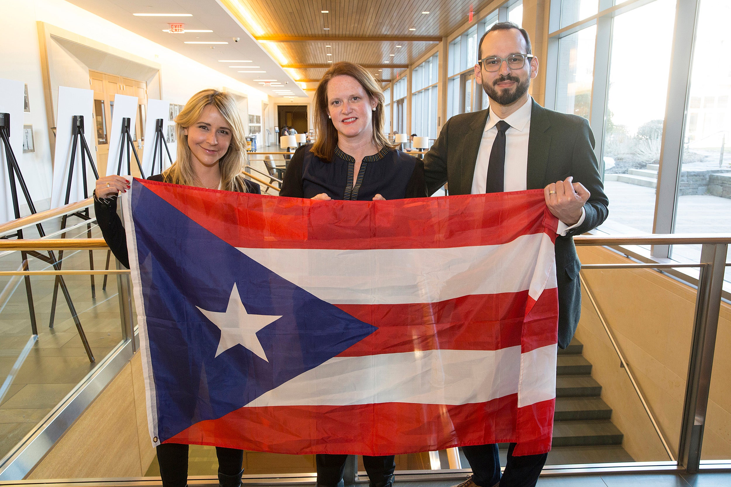 Natalie Trigo Reyes, J.D. '19 (from left), Lee Mestre, and Andrew Crespo '08, assistant professor of law, led a group of Law School students to Puerto Rico over spring break to offer legal aid to residents and help rebuild their homes and communities.