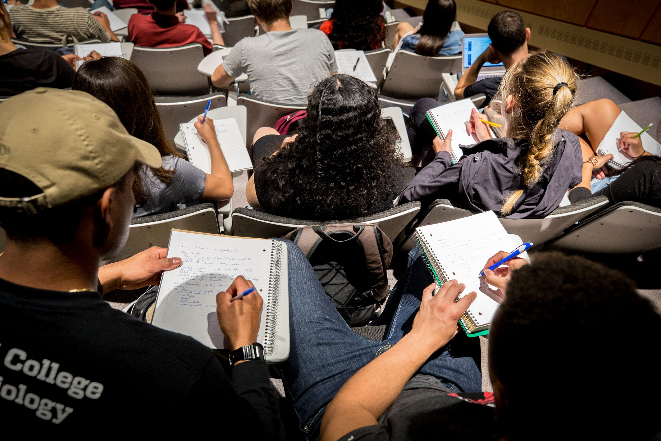 Students taking notes