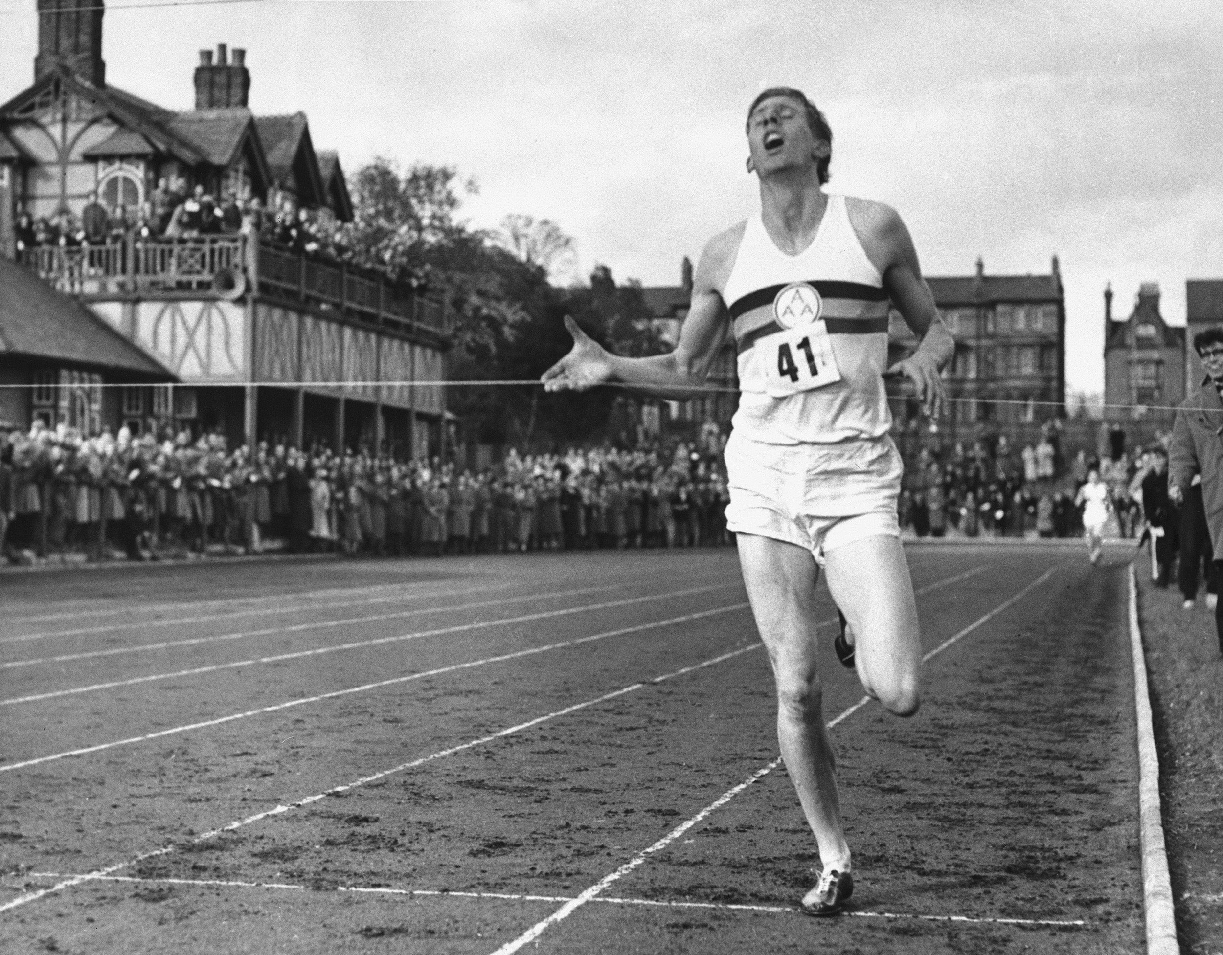 Runner Roger Bannister breaks the tape.