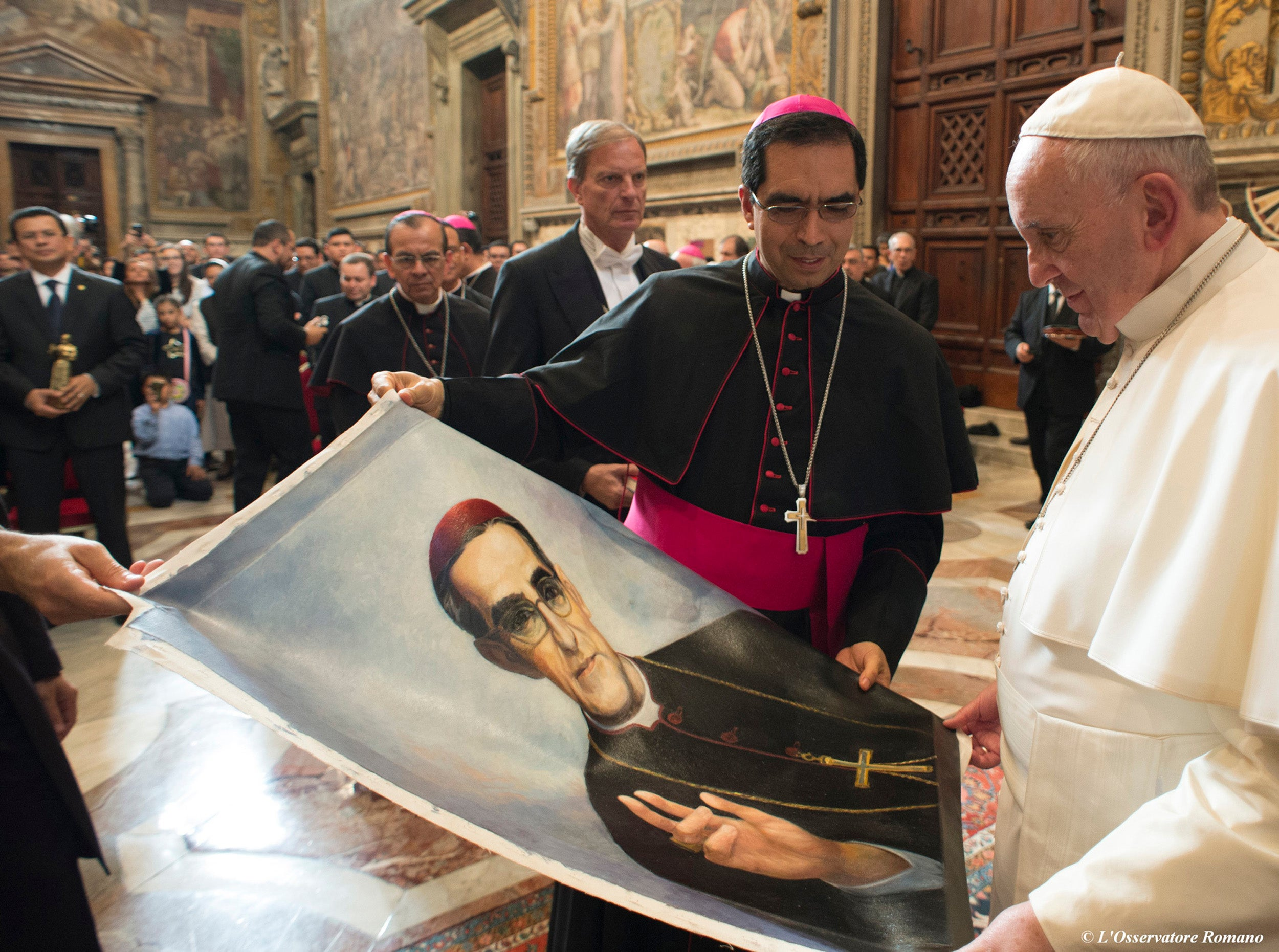 Pope Francis is presented with an image of Archbishop Oscar Romero at the Vatican in 2015.