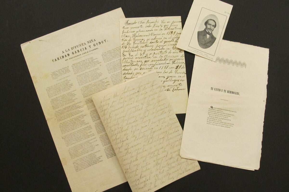 documents such as articles, handwritten notes, and pictures are available for viewing the newly digitized Escoto collection.