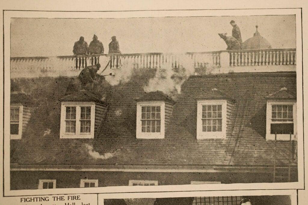 Harvard Crimson clipping shows firefighters battling Mass Hall blaze in 1924.