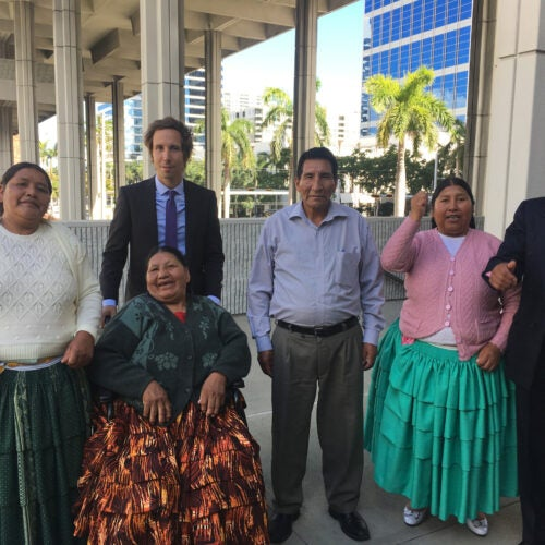 Thomas Becker, J.D. '08 (second from left), with relatives of the eight people slain in a 2003 Bolivian massacre who are suing their former president for the killings with the help of the Human Rights Program at HLS.