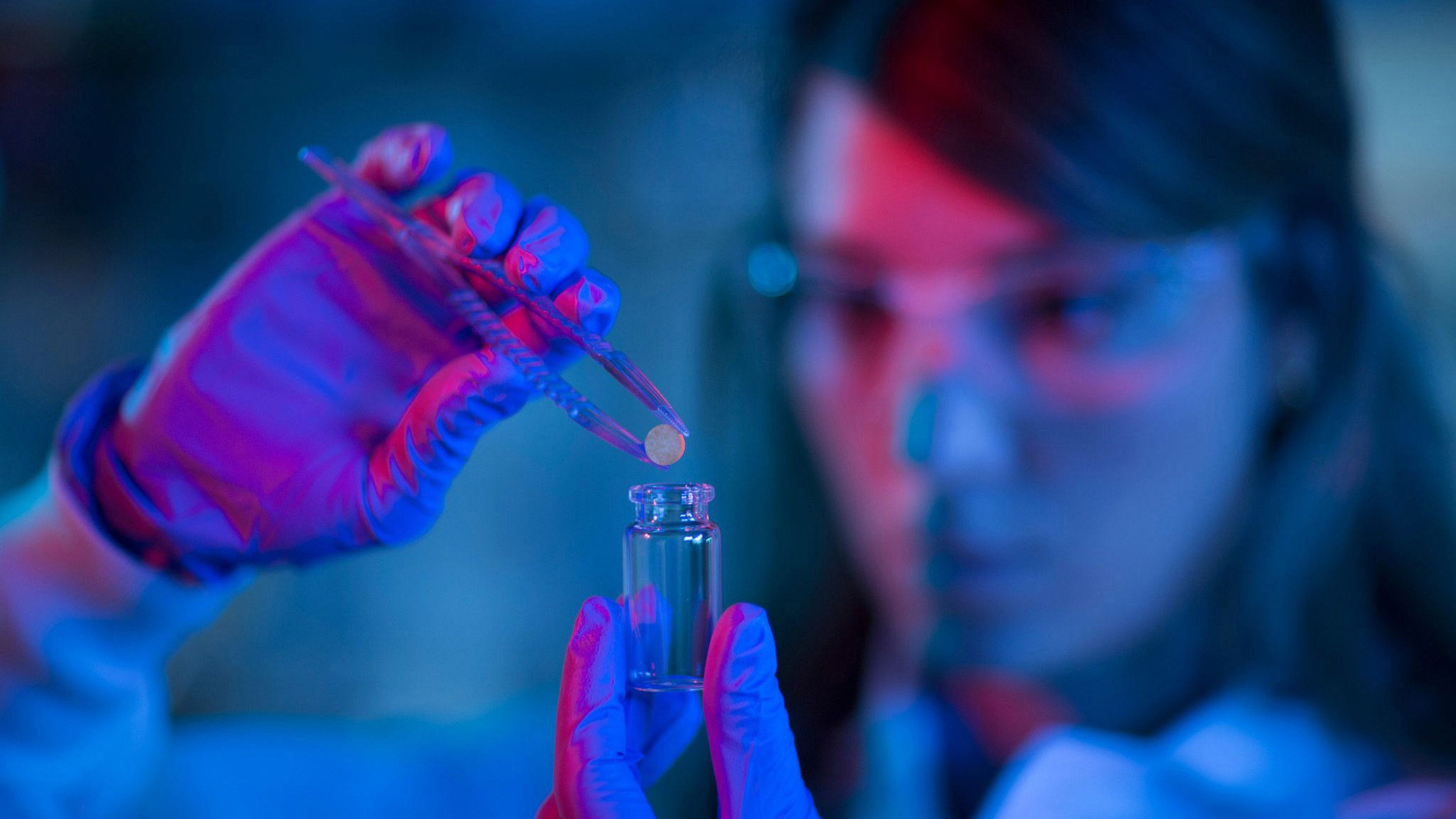 researcher holds a device