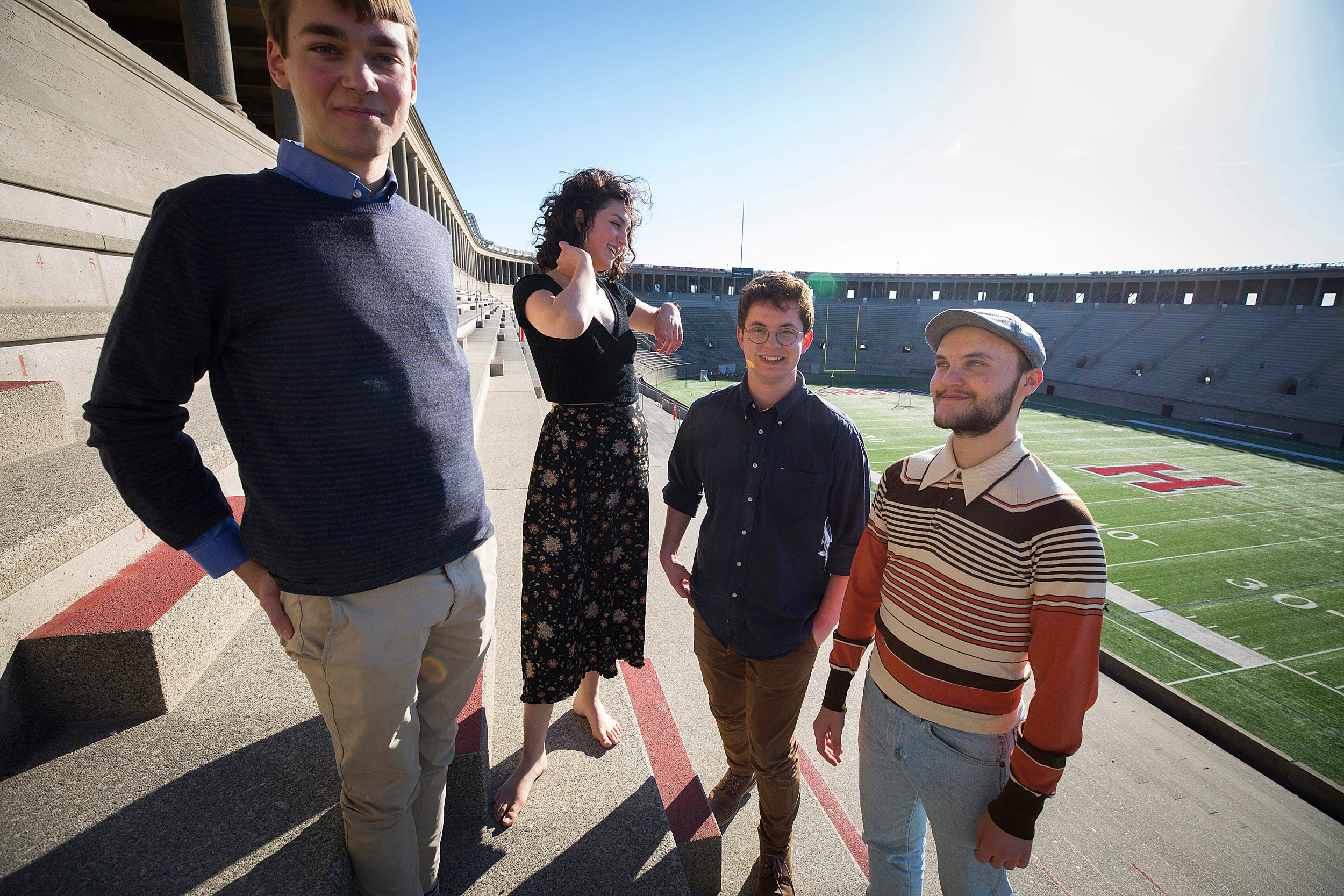 """Mateo Lincoln '19 (from left), Chloe Brooks '19, Mitchell Polonsky '19, and Ben Roy '20 are coordinating the production of """"Antigone"""" at Harvard Stadium, the final event in Harvard's annual Arts First festival."""