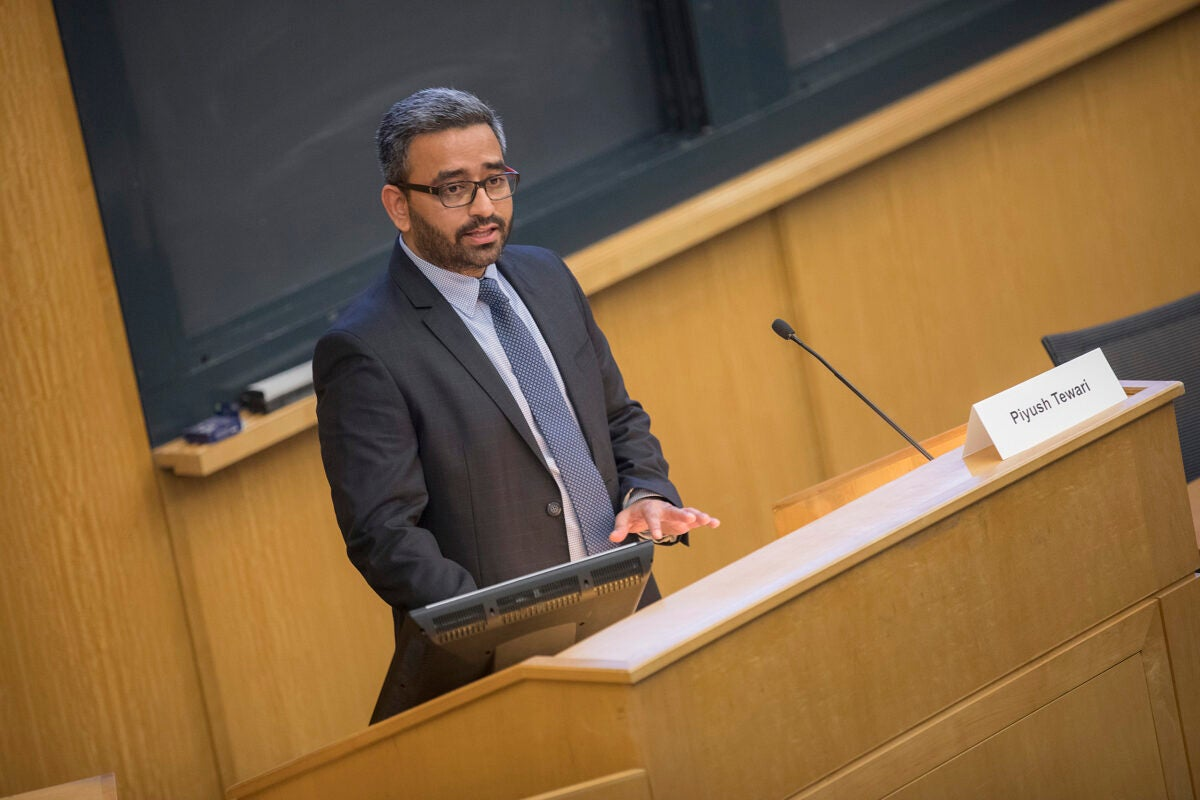 Keynote speaker Piyush Tewari speaks about his cousin's death in a hit-and-run that prompted him to create the SaveLIFE Foundation during a half-day symposium on traffic safety around the globe.